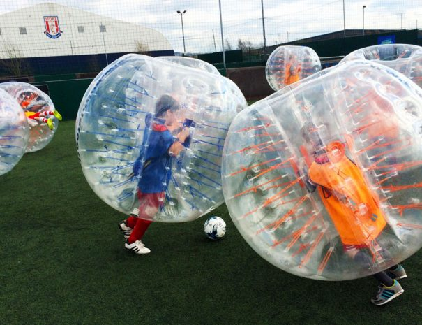 Kids playing bubble football